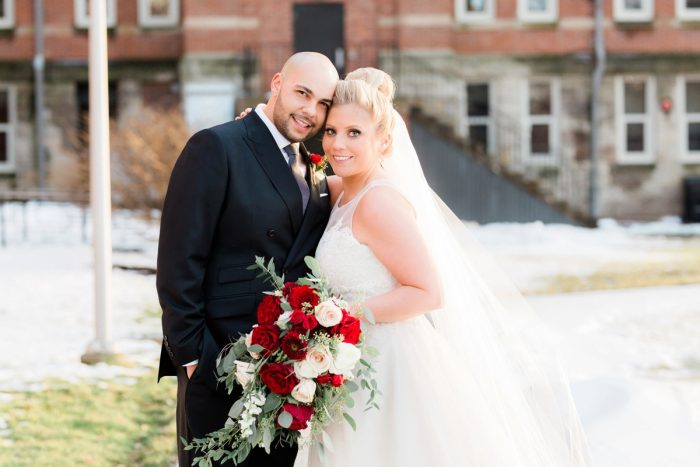 Bride with Red and White Wedding Bouquet: Warm & Romantic Winter Wedding at Duquesne from Loren DeMarco Photography featured on Burgh Brides