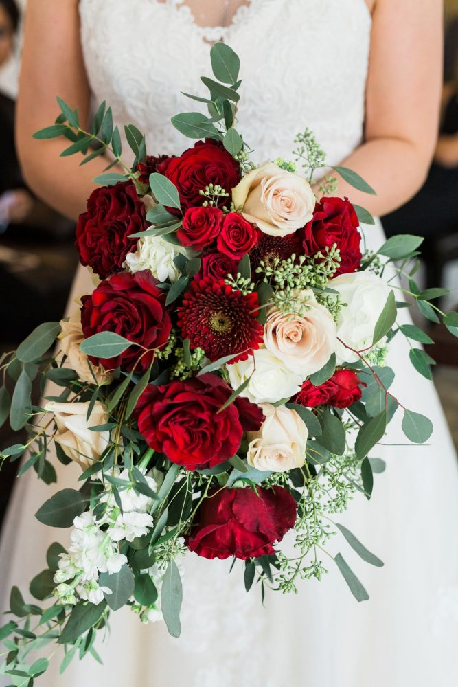 Red and White Bridal Bouquet: Warm & Romantic Winter Wedding at Duquesne from Loren DeMarco Photography featured on Burgh Brides