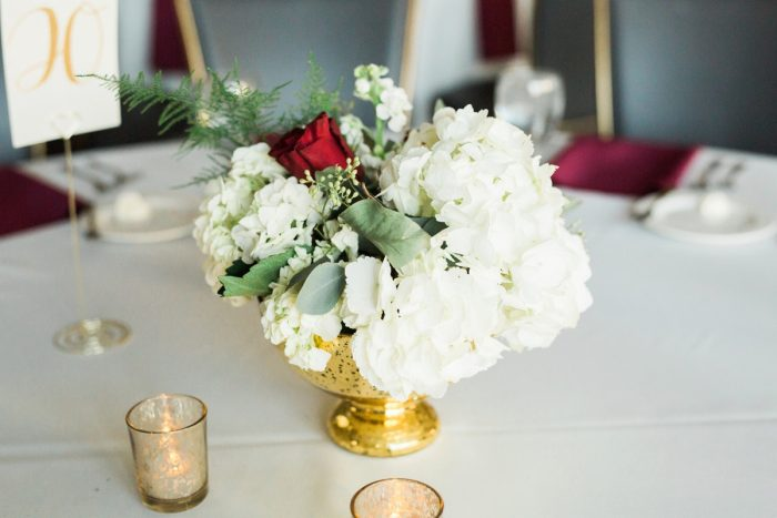 Red and White Wedding Centerpieces in Gold Vase: Warm & Romantic Winter Wedding at Duquesne from Loren DeMarco Photography featured on Burgh Brides