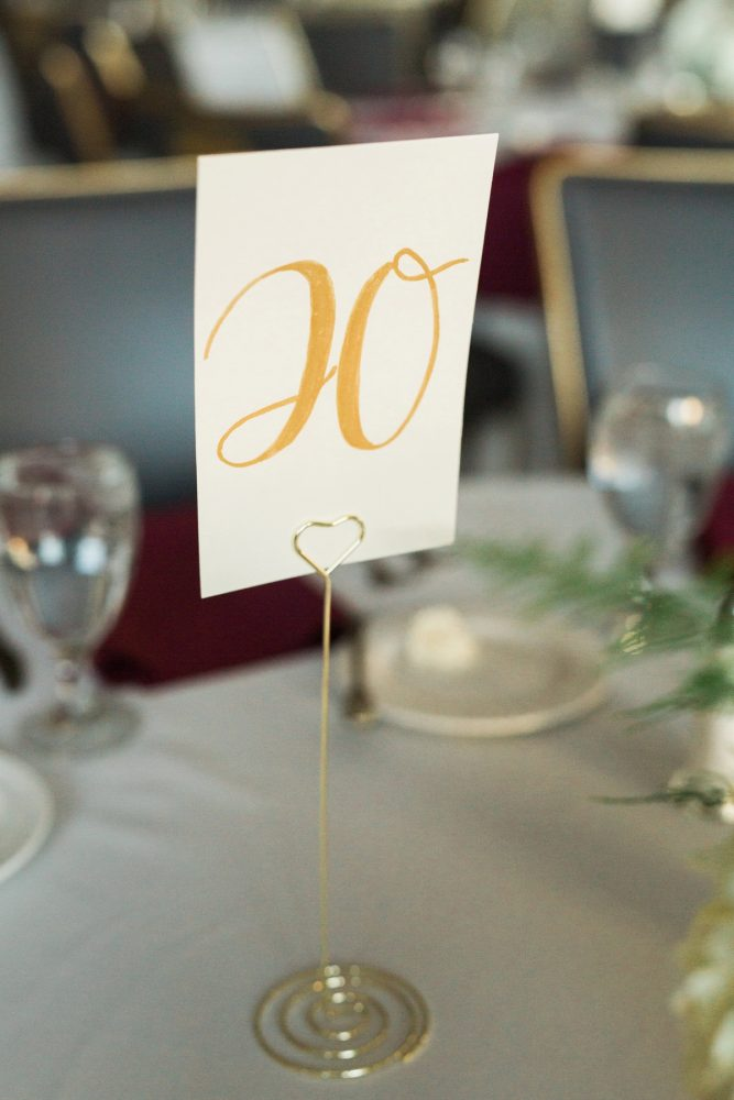 Hand Lettered Gold Wedding Table Numbers: Warm & Romantic Winter Wedding at Duquesne from Loren DeMarco Photography featured on Burgh Brides