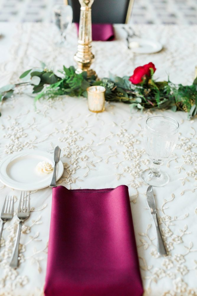 Burgundy Napkin on Brocade Linens at Wedding: Warm & Romantic Winter Wedding at Duquesne from Loren DeMarco Photography featured on Burgh Brides