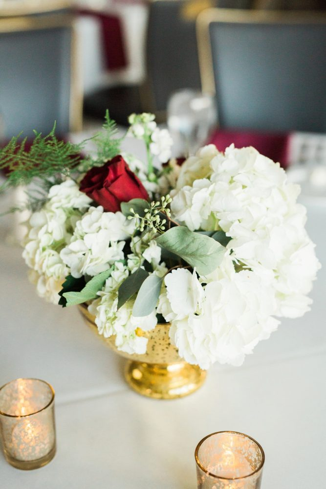 Red and White Wedding Flowers in Gold Vase: Warm & Romantic Winter Wedding at Duquesne from Loren DeMarco Photography featured on Burgh Brides