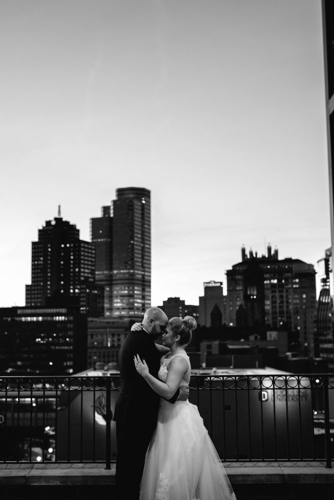 Bride and Groom with City Skyline in Background: Warm & Romantic Winter Wedding at Duquesne from Loren DeMarco Photography featured on Burgh Brides