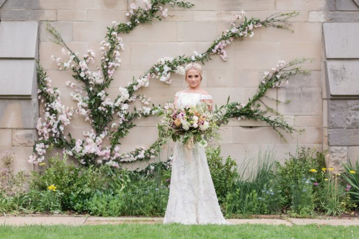 Bride in front of cherry blossoms: English Garden Wedding Inspiration from Hello Productions and April Smith Photography featured on Burgh Brides