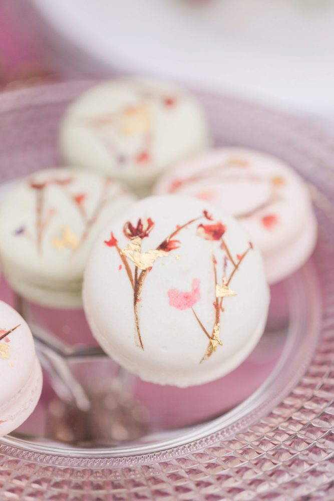 Hand painted macarons with edible flowers: English Garden Wedding Inspiration from Hello Productions and April Smith Photography featured on Burgh Brides