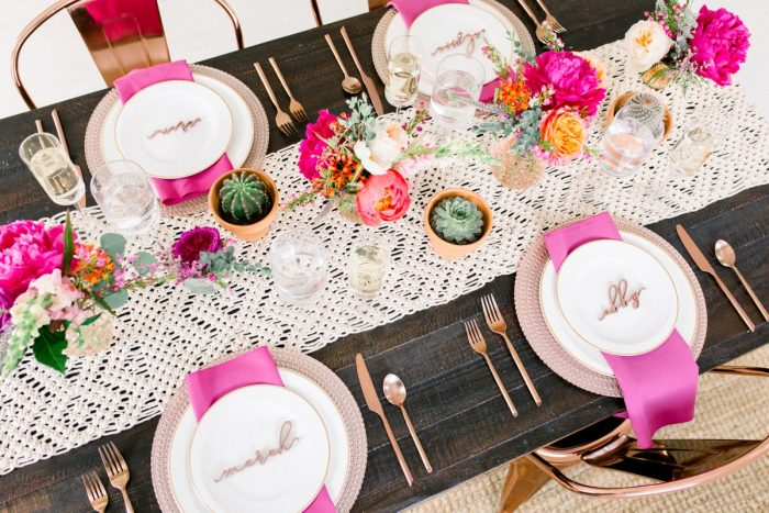 Macrame Table Runner on Wooden Table with Pink Napkins: Girly Cactus Themed Bridal Shower Inspiration from Olive & Rose Events and Abbie Tyler Photography featured on Burgh Brides