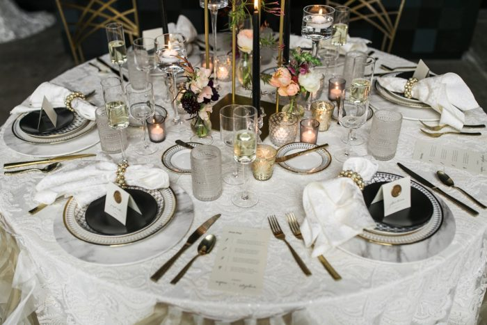 Ivory Table Linen with Gold Place Settings and Candles: Romantic Edgy Wedding Inspiration from Poppy Events & Steven Dray Images featured on Burgh Brides