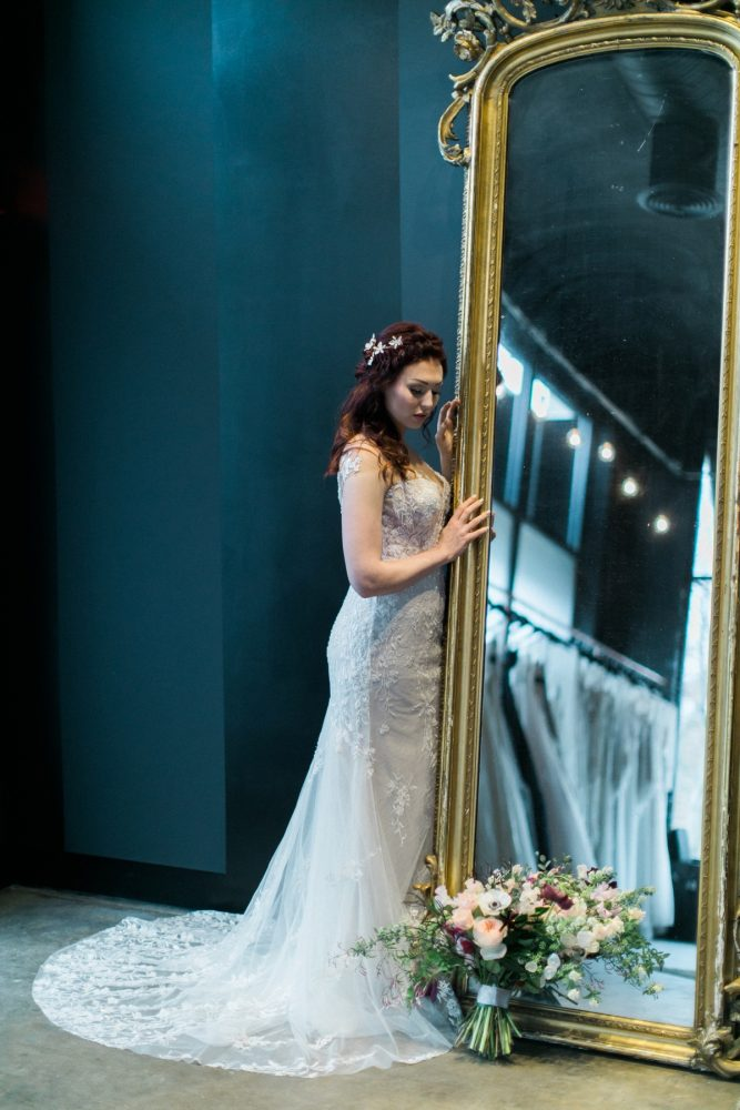 Bride in wedding dress standing at gold mirror: Romantic Edgy Wedding Inspiration from Poppy Events & Steven Dray Images featured on Burgh Brides
