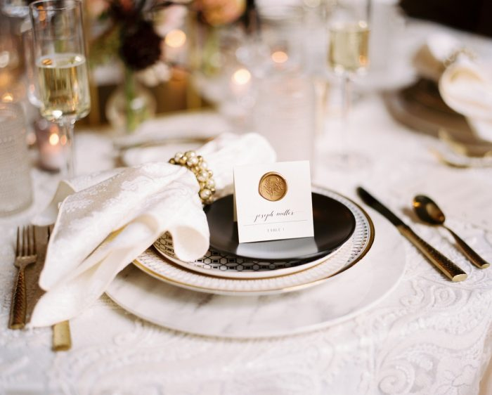 Wedding place setting escort card with gold wax seal pearl napkin ring: Romantic Edgy Wedding Inspiration from Poppy Events & Steven Dray Images featured on Burgh Brides