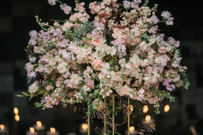 Wedding centerpiece pink and white florals in gold stand: Romantic Edgy Wedding Inspiration from Poppy Events & Steven Dray Images featured on Burgh Brides