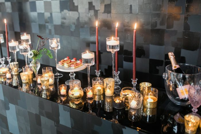 Candles in mercury glass vases: Romantic Edgy Wedding Inspiration from Poppy Events & Steven Dray Images featured on Burgh Brides