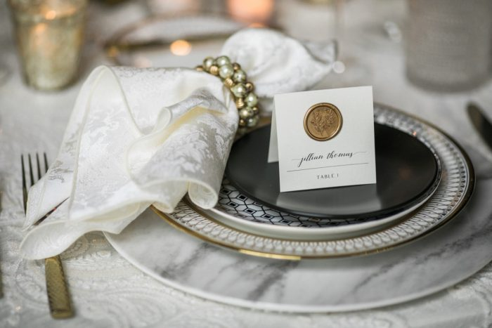 Gold wax seal on escort card pearl napkin ring: Romantic Edgy Wedding Inspiration from Poppy Events & Steven Dray Images featured on Burgh Brides