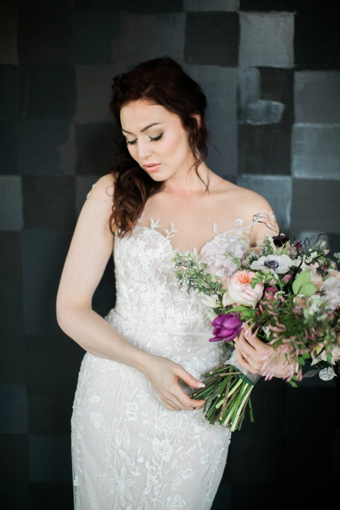Bride in wedding dress illusion lace pink and purple flowers: Romantic Edgy Wedding Inspiration from Poppy Events & Steven Dray Images featured on Burgh Brides