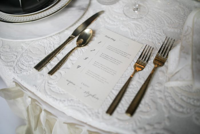Ivory menu card gold flatware: Romantic Edgy Wedding Inspiration from Poppy Events & Steven Dray Images featured on Burgh Brides