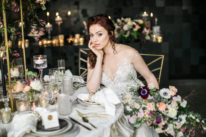 Bride sitting at wedding table in gold chair: Romantic Edgy Wedding Inspiration from Poppy Events & Steven Dray Images featured on Burgh Brides