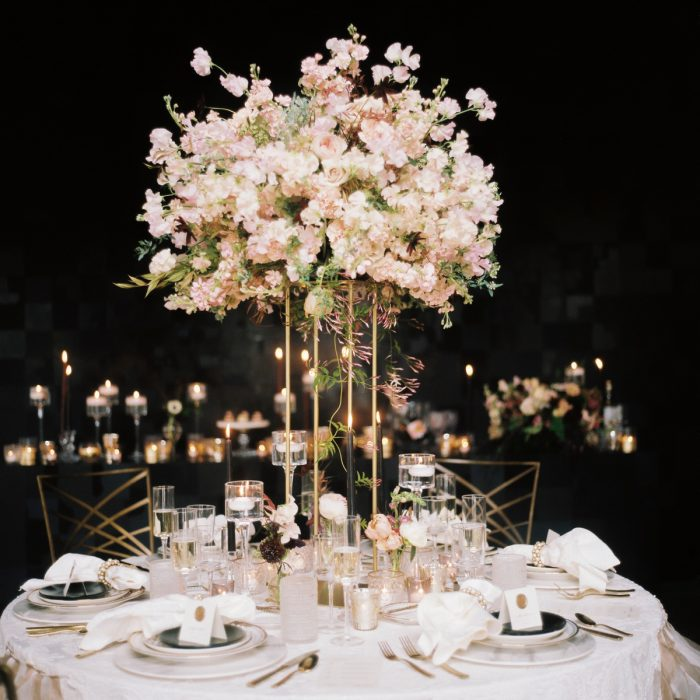 Wedding table pink and white flowers elevated gold stand candlelight: Romantic Edgy Wedding Inspiration from Poppy Events & Steven Dray Images featured on Burgh Brides