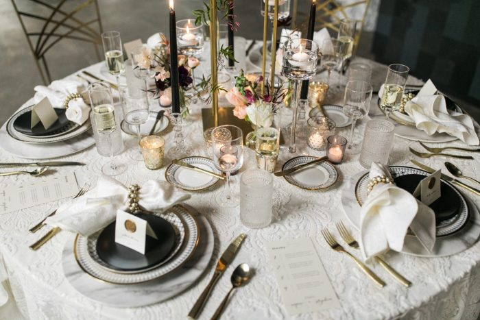 Ivory linen gold place setting candlelight wedding: Romantic Edgy Wedding Inspiration from Poppy Events & Steven Dray Images featured on Burgh Brides