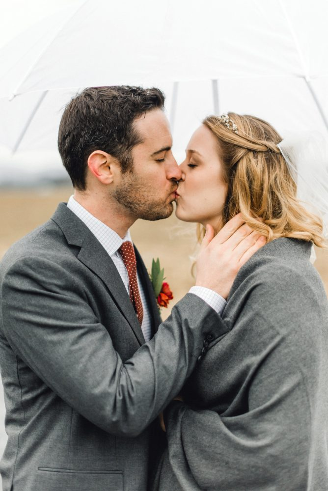 Bride Groom Kissing: Whimsical Greenhouse Wedding at Quality Gardens from Dawn Derbyshire Photography featured on Burgh Brides
