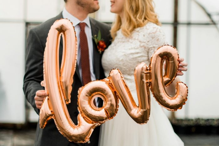 Bride Groom Gold Love Balloon: Whimsical Greenhouse Wedding at Quality Gardens from Dawn Derbyshire Photography featured on Burgh Brides