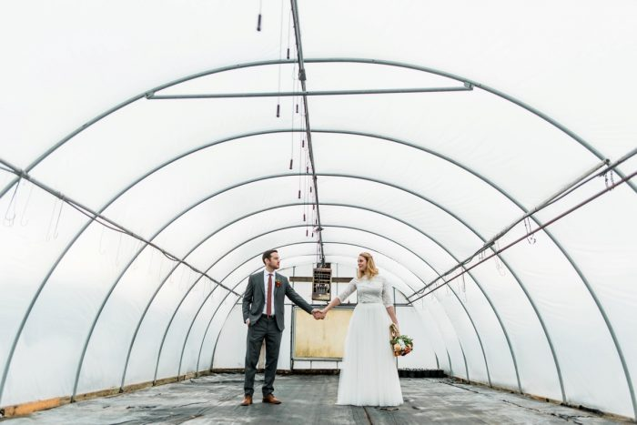 Bride Groom Holding Hands Greenhouse: Whimsical Greenhouse Wedding at Quality Gardens from Dawn Derbyshire Photography featured on Burgh Brides
