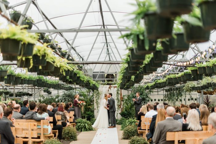 Bride Groom First Kiss Greenhouse: Whimsical Greenhouse Wedding at Quality Gardens from Dawn Derbyshire Photography featured on Burgh Brides