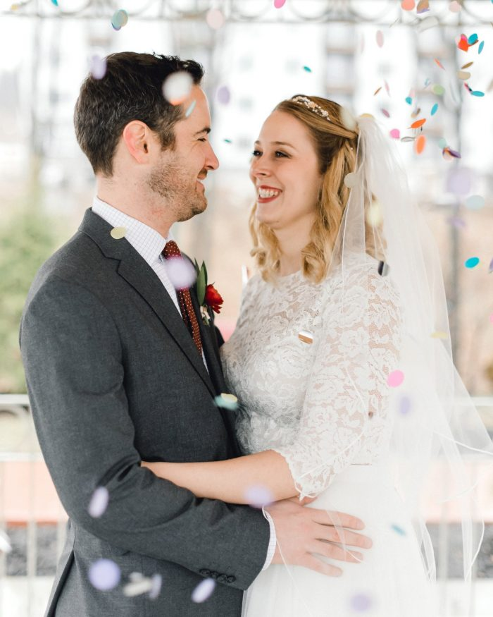 Bride and Groom Hugging with Rainbow Confetti Falling: Whimsical Greenhouse Wedding at Quality Gardens from Dawn Derbyshire Photography featured on Burgh Brides