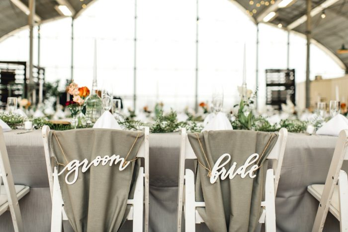 Groom and Bride Chair Signs: Whimsical Greenhouse Wedding at Quality Gardens from Dawn Derbyshire Photography featured on Burgh Brides