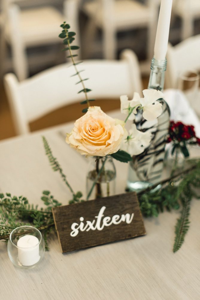 Wooden Calligraphy Table Numbers: Whimsical Greenhouse Wedding at Quality Gardens from Dawn Derbyshire Photography featured on Burgh Brides