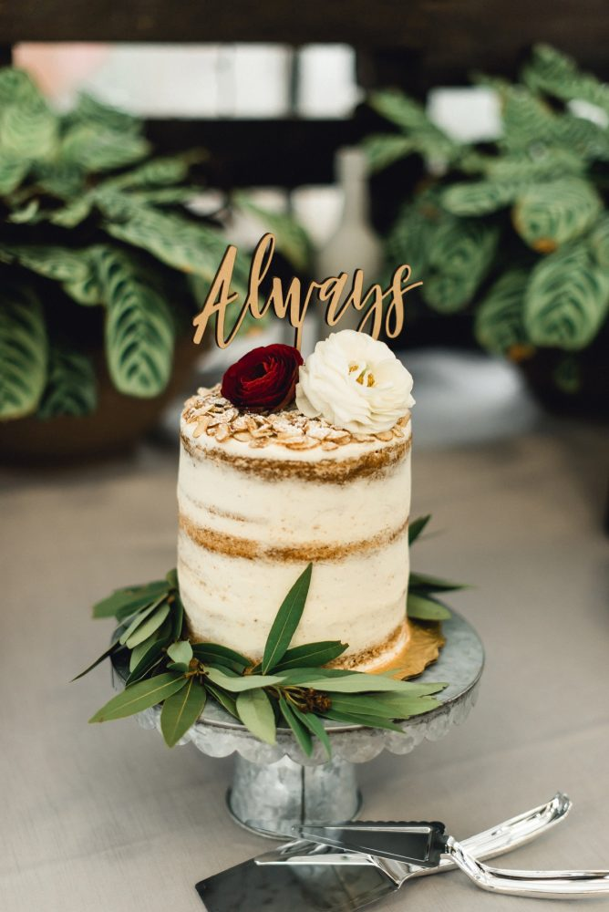 Naked Wedding Cake with Wooden Cake Topper: Whimsical Greenhouse Wedding at Quality Gardens from Dawn Derbyshire Photography featured on Burgh Brides