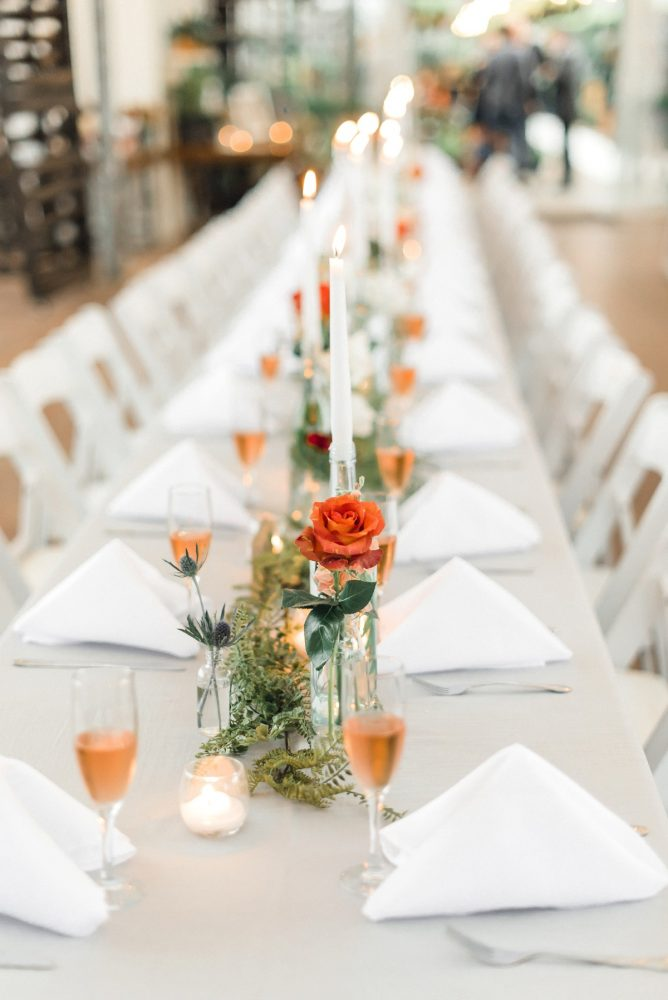 Moss Table Runner Orange Roses Glasses of Champagne: Whimsical Greenhouse Wedding at Quality Gardens from Dawn Derbyshire Photography featured on Burgh Brides
