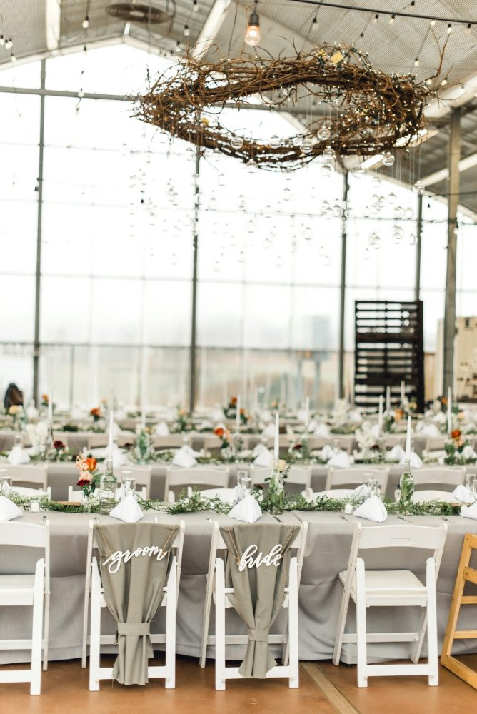 Hanging Branch Wreaths Greenery Table Runners Groom Bride Chair Signs: Whimsical Greenhouse Wedding at Quality Gardens from Dawn Derbyshire Photography featured on Burgh Brides