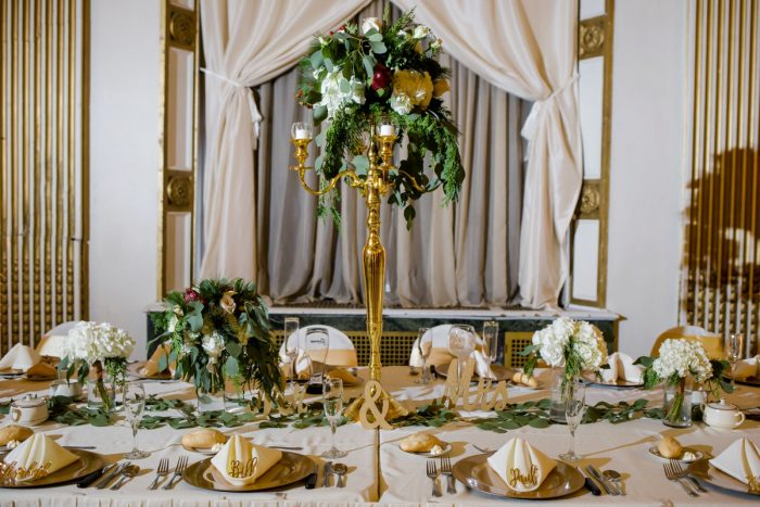 White and Green Wedding Centerpieces on Gold Stand: Magical Christmas Wedding at the George Washington Hotel from Weddings by Alisa featured on Burgh Brides