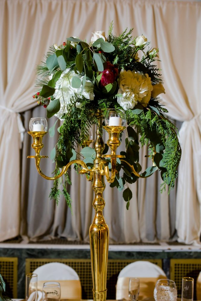 Green and White Winter Wedding Centerpiece on Gold Stand: Magical Christmas Wedding at the George Washington Hotel from Weddings by Alisa featured on Burgh Brides