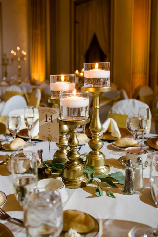 Trio of Floating Candles in Gold Candlesticks: Magical Christmas Wedding at the George Washington Hotel from Weddings by Alisa featured on Burgh Brides
