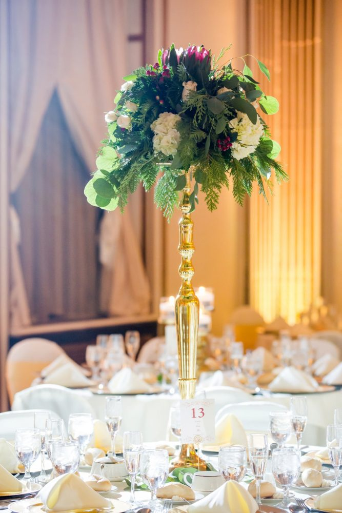 Green and White Wedding Centerpieces in Gold Stands: Magical Christmas Wedding at the George Washington Hotel from Weddings by Alisa featured on Burgh Brides