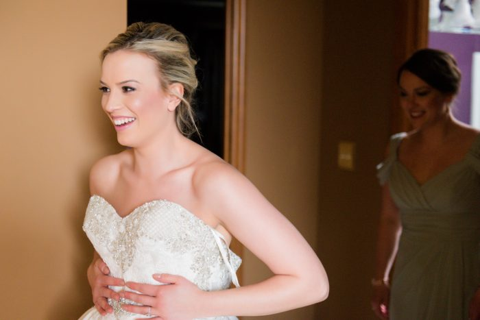 Bride Getting Dressed in Sweetheart Neck Wedding Dress: Girly & Glamorous Wedding at Oakmont Country Club from Leeann Marie Photography featured on Burgh Brides