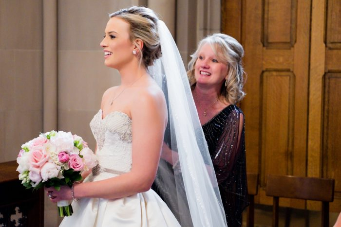 Bride and Mom at Wedding Ceremony: Girly & Glamorous Wedding at Oakmont Country Club from Leeann Marie Photography featured on Burgh Brides