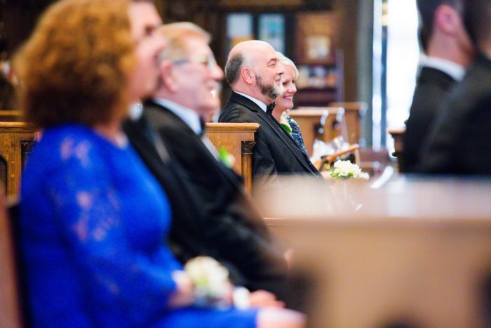 Family at Wedding Ceremony: Girly & Glamorous Wedding at Oakmont Country Club from Leeann Marie Photography featured on Burgh Brides