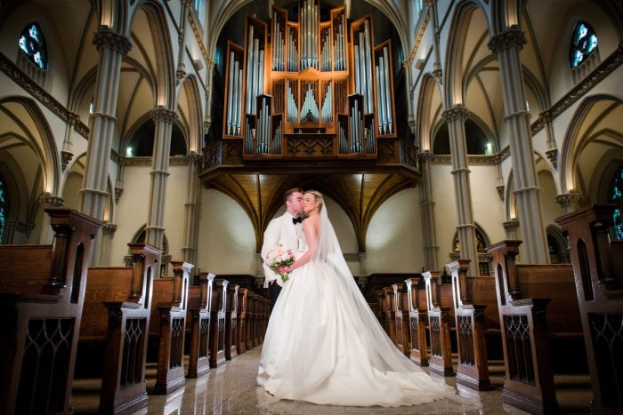 Bride and Groom at Church: Girly & Glamorous Wedding at Oakmont Country Club from Leeann Marie Photography featured on Burgh Brides