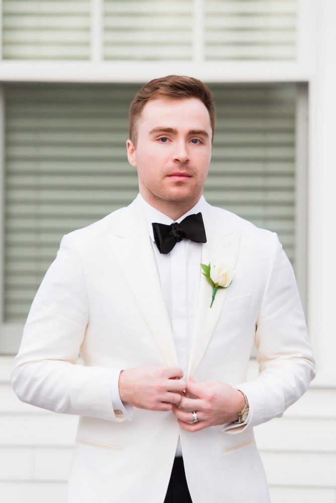 Groom in White Tuxedo Jacket: Girly & Glamorous Wedding at Oakmont Country Club from Leeann Marie Photography featured on Burgh Brides
