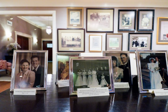 Family Photos on Display at Wedding: Girly & Glamorous Wedding at Oakmont Country Club from Leeann Marie Photography featured on Burgh Brides