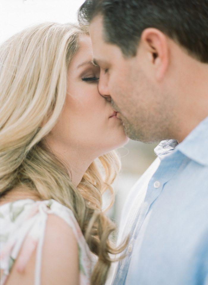 Romantic kissing engagement photo. See more engagement photo ideas at burghbrides.com.