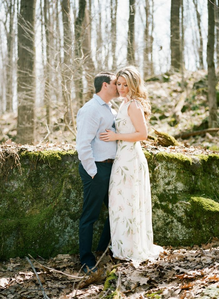 Engagement photos in the woods. See more engagement photo ideas at burghbrides.com.
