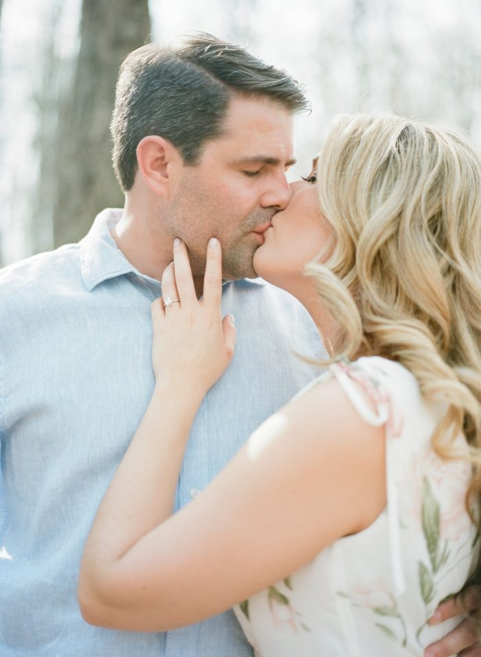 Bride kissing groom engagement photo. See more engagement photo ideas at burghbrides.com.
