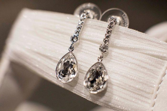 Drop Statement Bridal Earrings: Warm December Embassy Suites Wedding from Dorosh Documentaries featured on Burgh Brides