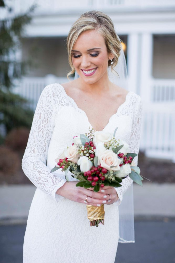Red and White Bridal Bouquet: Warm December Embassy Suites Wedding from Dorosh Documentaries featured on Burgh Brides