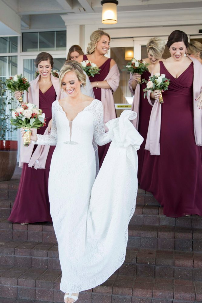 Cranberry Bridesmaids Dresses: Warm December Embassy Suites Wedding from Dorosh Documentaries featured on Burgh Brides