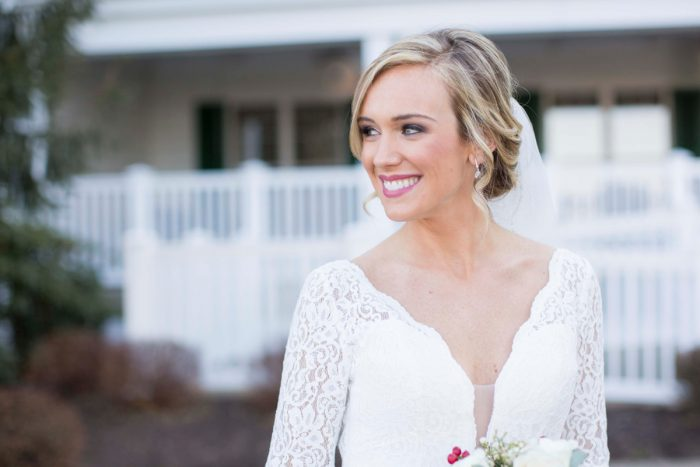 V Neck Wedding Dress: Warm December Embassy Suites Wedding from Dorosh Documentaries featured on Burgh Brides