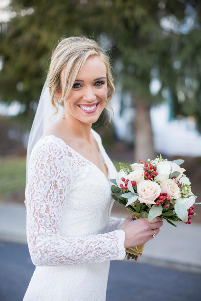 Long Sleeve Lace Wedding Dress: Warm December Embassy Suites Wedding from Dorosh Documentaries featured on Burgh Brides