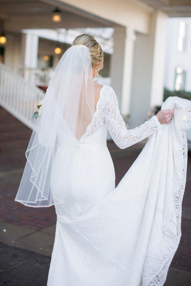 V Back Wedding Dress: Warm December Embassy Suites Wedding from Dorosh Documentaries featured on Burgh Brides